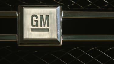 The General Motors logo appears on a car in Berlin
