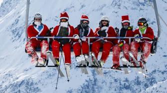Santas go for a ski.