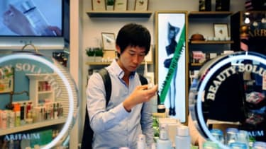 A 24-year-old South Korean college student shops for skincare and makeup products at a cosmetics store in Seoul.