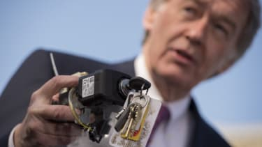 Sen. Edward Markey (D-Mass.) holds up a faulty General Motors ignition switch during a press conference.