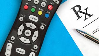 A television remote and a prescription form.
