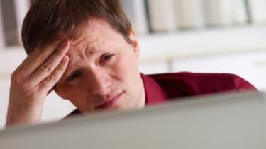 Stressed man computer