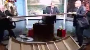 Cable news pundits destroy studio in on-air brawl