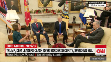 Government leaders meet in the Oval Office.