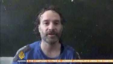 Islamist militants release captive U.S. journalist Peter Theo Curtis in Syria
