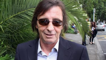 Murder-for-hire charge against AC/DC drummer now dropped, still faces other accusations