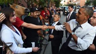 Man wearing horse-head mask gets handshake with President Obama