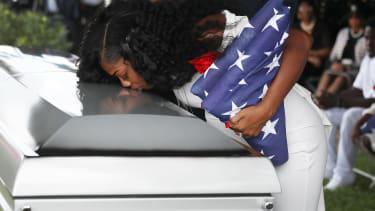 Myeshia Johnson kisses her husband's casket