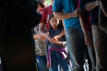 Migrants wait to be processed in Texas.