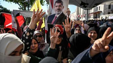 Egyptians mourn former president Mohamed Morsi.
