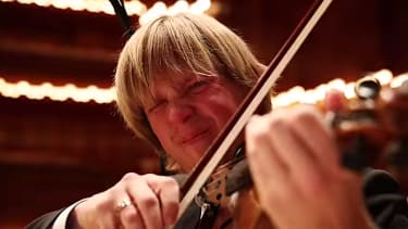 Watch a symphony orchestra try to make music after eating the world's hottest chili peppers