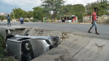 A car that was hit by a bus early Sunday in Haiti.