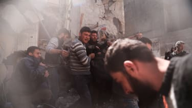 People search for survivors in Syria