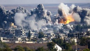 Smoke rises over Syrian town of Kobani after an airstrike.