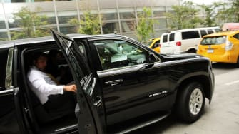 A passenger exits an Uber in New York City.
