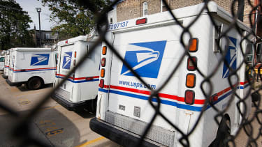 United States Postal Service trucks sit outside the Roberto Clemente Post Office August 25, 2009 in Chicago, Illinois.