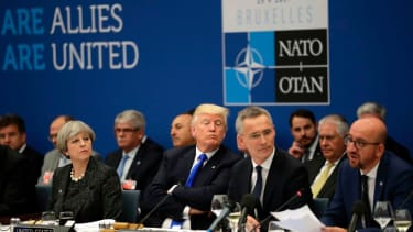 Trump sits with NATO members and leaders