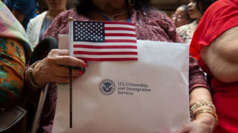 A new citizen holds an American flag.