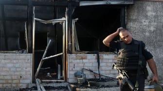 Investigator at scene of arson