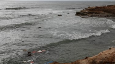 Debris floats off Point Loma after a suspected smuggling boat capsized.