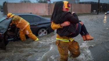 A woman is rescued from flooding in California