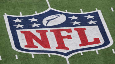 The NFL logo painted on turf