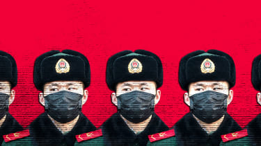 Chinese police officer in face mask.