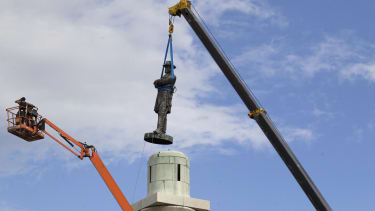 A statue of Confederate General Robert E. Lee is removed in New Orleans.