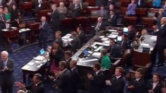 The Senate floor claps for Senator John McCain.