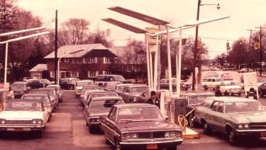 Cars line up to get gas during the oil crisis of the 1970s.