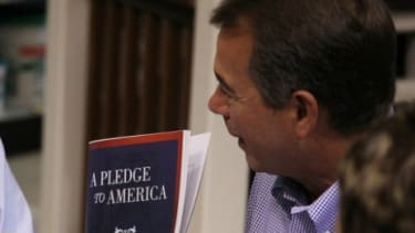"""John Boehner shows off the """"Pledge To America"""" during an unveiling event hosted by Tart Lumber in Sterling, Virginia."""