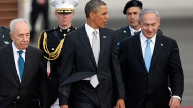 Israeli President Shimon Peres and Prime Minister Benjamin Netanyahu walk with Preident Obama before his departure from Gurion International Airport, March 22.