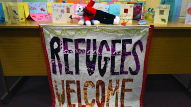 A refugees welcome sign.
