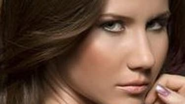 Anna Chapman, a 28-year-old working in real estate, is among the 11 accused of espionage.