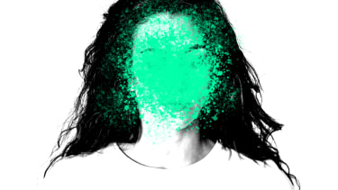 A woman with her face obscured.