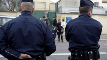French police stand guard outside a Jewish school in Villeurbanne: The country's religious schools and buildings have beefed up security after a deadly attack at a Jewish school Monday.