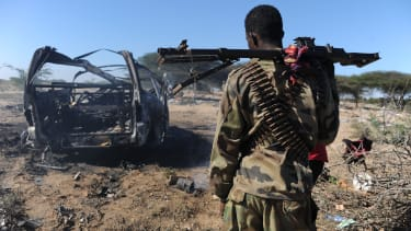 The site of a car bomb in Somalia.