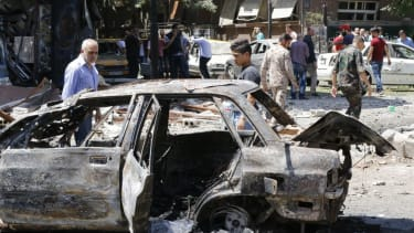 The aftermath of a car bombing in Damascus, Syria