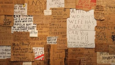To raise awareness, man buys signs from the homeless, turns them into art