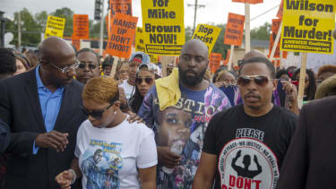 3 weeks after Michael Brown's death, Ferguson holds peaceful march