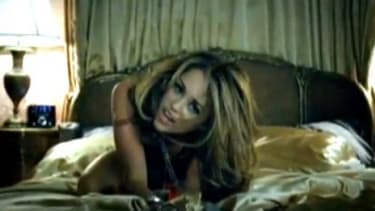 Miley's newest music video shows her sprawled out on a bed, and later dancing in a nightclub with older men.