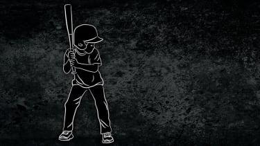 A boy playing baseball.