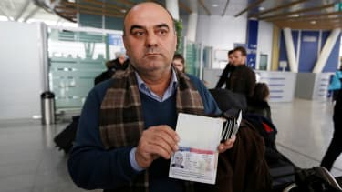Fuad Sharef Suleman shows his U.S. visa after returning to Iraq from Egypt, where he was prevented from boarding a plane to the U.S. on Jan. 29, 2017.