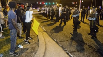 Protesters and police officers in Baton Rouge, Louisiana.