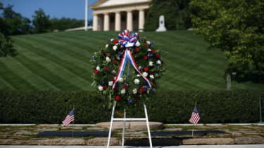 A wreath stands in front of the gravesite of President Kennedy at Arlington National Cemetery in 2012.