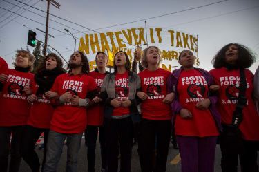 Workers protest for $15 minimum wage.