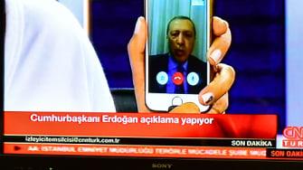 Turkish President Recep Tayyip Erdogan communicates through FaceTime.