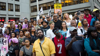 Supporters of Colin Kaepernick outside the NFL's Manhattan headquarters.