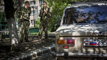 Russia offers Donetsk rebels troop support to 'avert an impending humanitarian crisis'