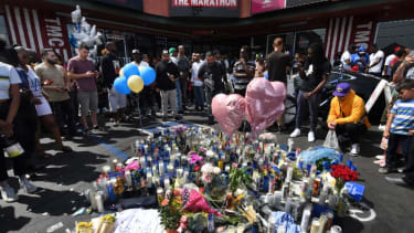 Mourners gather outside Nipsey Hussle's clothing store in Los Angeles.